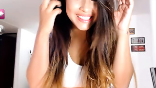 Hot teenie plays in front of her web camera