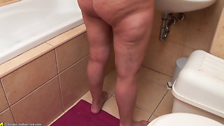 Old golden-haired masturbating in the bathroom