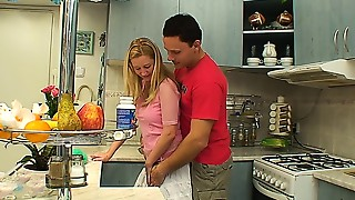 Sexy golden-haired teen getting fucked in the kitchen