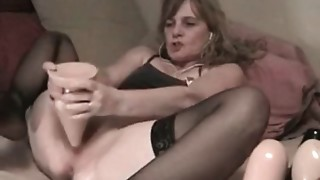 Non-professional wife with huge vibrator in her a-hole