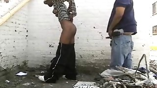 humping slut behind building