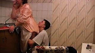 Granny acquires drilled in kitchen by her young lover
