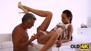 OLD4K. Tanned black hair cutie facialized after excellent intercourse...