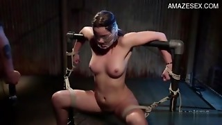 Roped up serf angel Dani Daniels receives screwed with a fake penis machine
