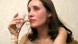 Stripped dark brown drinks and masturbates alone in arm-chair