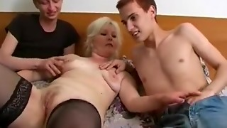 Experienced woman serves 3 slender guys in one daybed