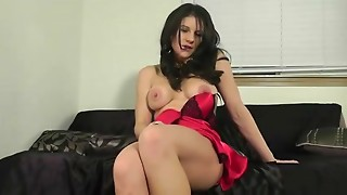 Excited strumpet in hot underware plays with sex-toy in sofa