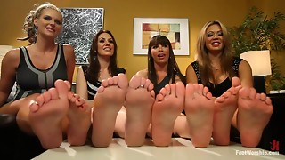 Group footjob for a fortunate fellow