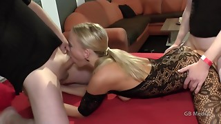 Blond hooker in fishnet bodystocking addicted to trio intercourse