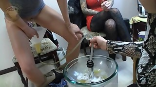 Femdom porn scene with 3 mistresses forcing a human latrine to swallow their pee