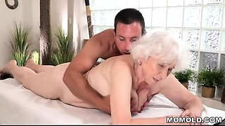Mature mamma Norma enjoys sex after massage